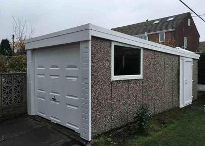 Pent Garage Refurbishment with Front Cladding