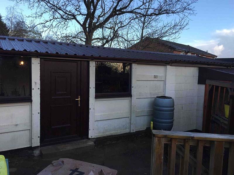 Black Garage Roof Replacement & Windows