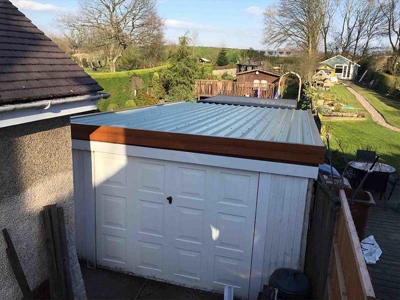 Pent Garage Roof with Light Oak uPVC