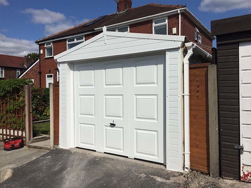 White Garage Cladding Around Garage Door