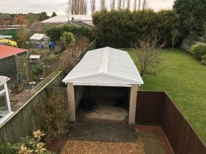 Concrete garage with an with new garage roof