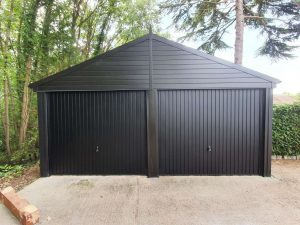 Double Garage Door replacement with Black Canopy Garage Doors