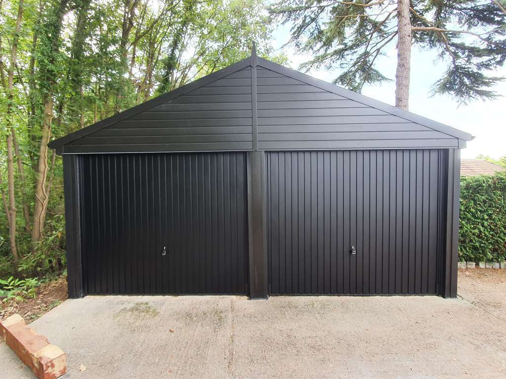 Double Garage Door replacement with Black Canopy Garage Doors
